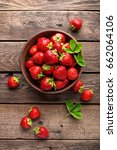 fresh juicy strawberries with... | Shutterstock . vector #662064106