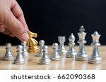 man hand put gold chess knight... | Shutterstock . vector #662090368