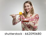 young smiling girl while eating ... | Shutterstock . vector #662090680