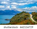 Gravel road called Carretera Austral passing along the shore of a beautiful lake General Carrera in the reomte part of southern Patagonia, Chile