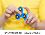 a boy is playing a popular toy... | Shutterstock . vector #662129668