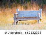 Weathered Wooden Bench In Fiel...
