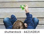 child playing with fidget... | Shutterstock . vector #662142814