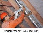 installer wraps the air duct...   Shutterstock . vector #662151484