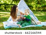 happy mother and little son... | Shutterstock . vector #662166544