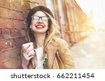 cheerful woman in the street... | Shutterstock . vector #662211454