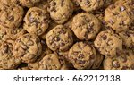 Small photo of many chocolate chip cookies stacked