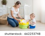 young smiling mother sitting on ... | Shutterstock . vector #662253748