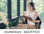 woman reading a book at the... | Shutterstock . vector #662257414
