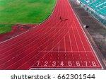 aerial man running on tracks     Shutterstock . vector #662301544