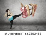 diet concept. overweight woman... | Shutterstock . vector #662303458