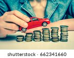 businesswoman and toy car on... | Shutterstock . vector #662341660