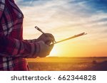 concerned female farmer writing ... | Shutterstock . vector #662344828