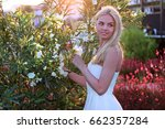 young woman in white dress in... | Shutterstock . vector #662357284