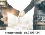 abstract handshake on city... | Shutterstock . vector #662408434