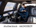 young business man in limo... | Shutterstock . vector #662433829