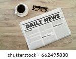 mockup newspaper on wood table. | Shutterstock . vector #662495830