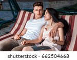 the guy with the girl sitting... | Shutterstock . vector #662504668
