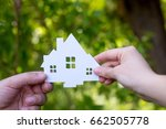 paper house in hands. rent of a ... | Shutterstock . vector #662505778