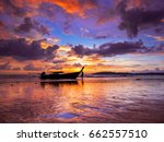 long tail boat at sunset on the ... | Shutterstock . vector #662557510