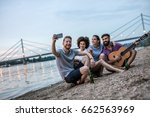 handsome guy playing a guitar... | Shutterstock . vector #662563969