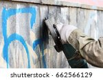 removal of graffiti on a... | Shutterstock . vector #662566129