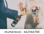 bride and groom with champagne | Shutterstock . vector #662566780