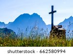 old cross at a cemetery - stock photo