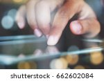 close up finger touching on... | Shutterstock . vector #662602084