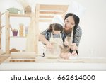 happy family in the kitchen.... | Shutterstock . vector #662614000