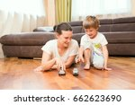 mom and her little son play car ... | Shutterstock . vector #662623690