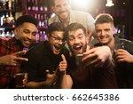 happy male friends taking...   Shutterstock . vector #662645386