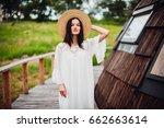 woman in white dress walks on... | Shutterstock . vector #662663614