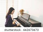 teen woman playing the piano. ...   Shutterstock . vector #662673673