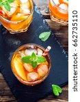 peach iced tea. iced tea with... | Shutterstock . vector #662735110
