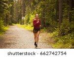 girl is jogging in the woods  | Shutterstock . vector #662742754