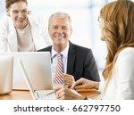 shot of a senior financial... | Shutterstock . vector #662797750