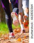 young couple jogging in park at ... | Shutterstock . vector #662832364