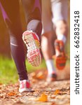 young couple jogging in park at ... | Shutterstock . vector #662832418