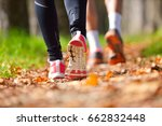 young couple jogging in park at ... | Shutterstock . vector #662832448