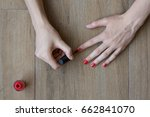 girl painting her nails | Shutterstock . vector #662841070