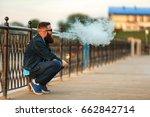 vape bearded man in real life.... | Shutterstock . vector #662842714