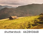 alone old wooden house in high... | Shutterstock . vector #662843668