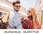shopping. beautiful young... | Shutterstock . vector #662847418