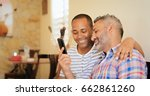 homosexual couple  gay hispanic ... | Shutterstock . vector #662861260