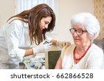 home healthcare nurse giving... | Shutterstock . vector #662866528