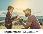happy father and little son are ... | Shutterstock . vector #662888374