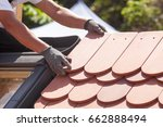 hands of roofer laying tile on... | Shutterstock . vector #662888494