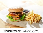 big tasty burger and fries on... | Shutterstock . vector #662919694