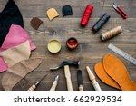 set of cobbler tools on brown... | Shutterstock . vector #662929534